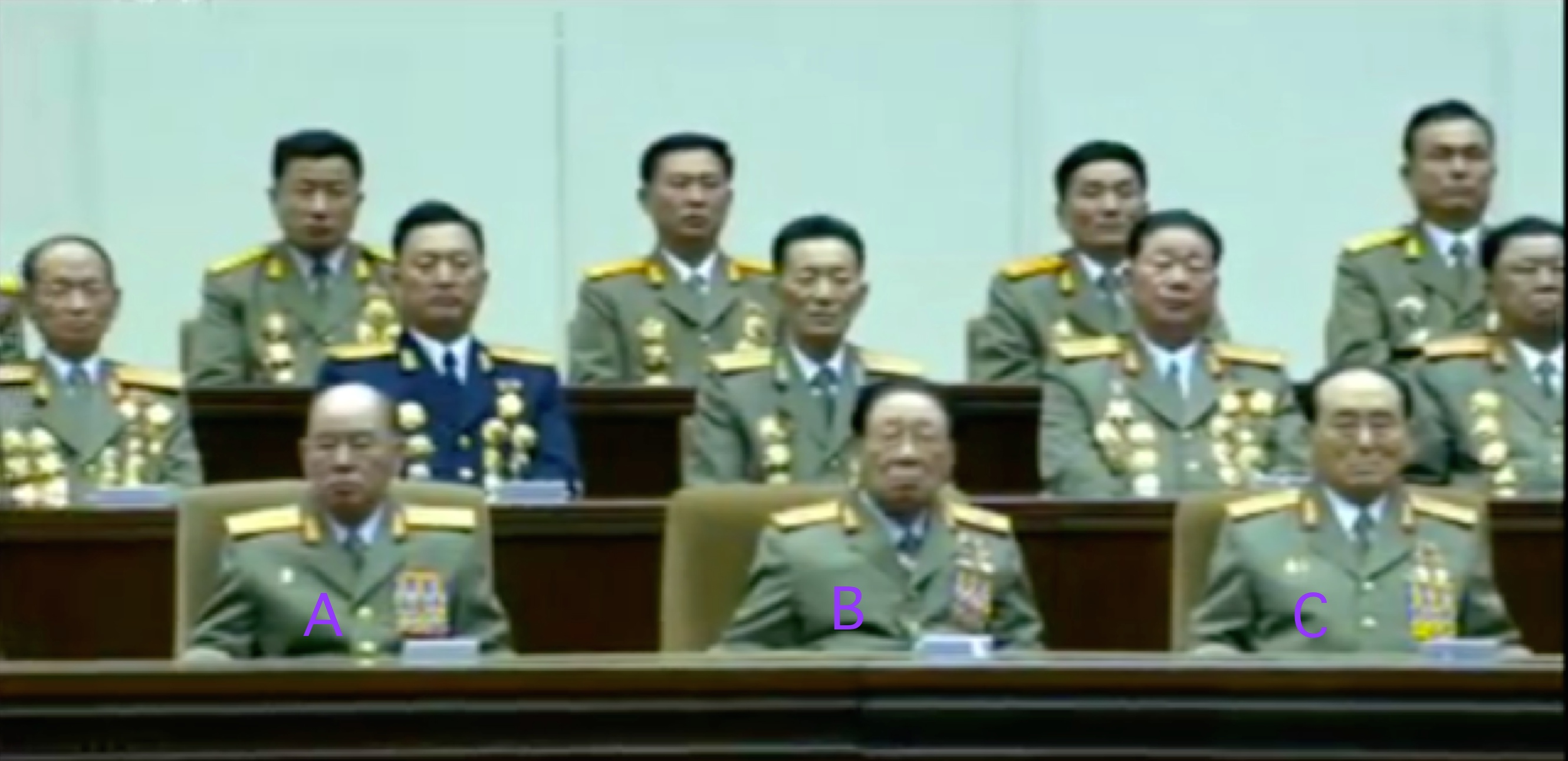 Chief of the KPA General Staff General Ri Myong Su (A), National Defense Commission Vice Chairman VMar Ri Yong Mu (B) and National Defense Commission Vice Chairman General O Kuk Ryol [C] on the platform for the central report meeting marking KJI's birthday (Photo: KCTV screen grabs).
