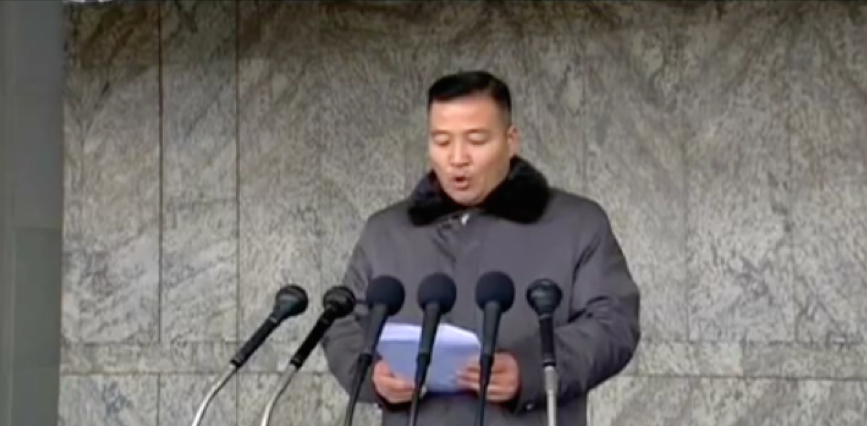 Kim Il Sung Youth League Central Committee Chairman Jon Yong Nam delivers a congratulatory speech at the February 8, 2016 mass rally (Photo: KCTV screen grab).