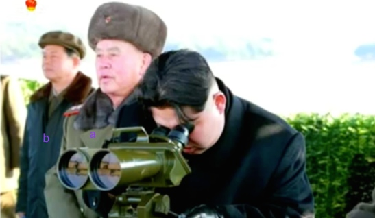 Kim Jong Un watches an anti-tank weapons test.  Also seen in attendance is Chief of the KPA General Staff Gen. Ri Myong Su [a] and Deputy Director of the WPK Military (machine-building) Industry Department Hyon Yong Chil [b] (Photo: KCTV screen grab).