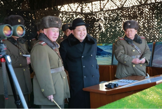 Kim Jong Un observes a combined forces exercise.  Also seen in attendance is General Ri Myong Su, appointed Chief of the KPA General Staff earlier this month (Photo: Rodong Sinmun).