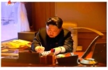 Image of Kim Jong Un authorizing the launch of Kwangmyo'ngso'ng-4 shown during a special news bulletin on Korean Central Television on February 7, 2016 (Photo: KCTV screengrab).