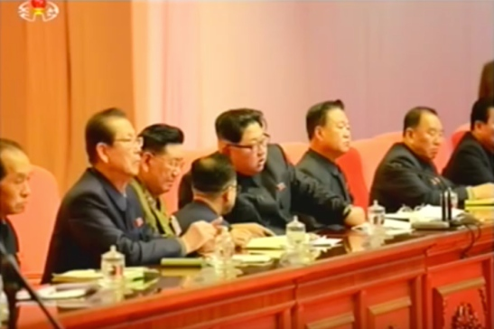 Kim Jong Un confers with a person aide during the joint expanded meeting of the WPK Central Committee and KPA WPK Committee (Photo: KCTV screen grab).