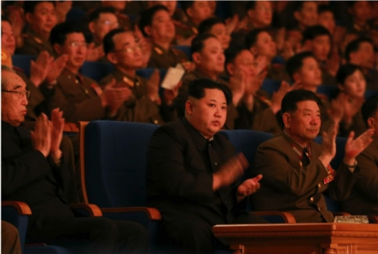 Kim Jong Un watches the KPA Military Band's concert marking its 70th anniversary.  Also in attendance with him are Kim Ki Nam (left) and General Pak Yong Sik (right) (Photo: Rodong Sinmun).