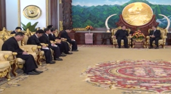 WPK Secretary Kim Yong Chol (background, left) meets with Lao President Choummaly Sayasone (background, right) in Vientiane on February 12, 2016 (Photo: KPL video screen grab).