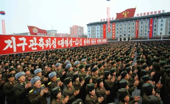 KPA service members applaud during a February 8, 2016 mass rally celebrating the successful launch of the KMS-4 (Photo: Rodong Sinmun).