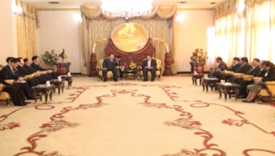 Minister of People's Security Choe Pu Il (background, L) and a delegation of Ministry of People's Security meet with Lao People's Revolutionary Party General-Secretary