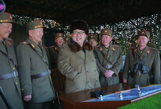 Kim Jong Un and members of the high command observe a large scale artillery drill (Photo: Rodong Sinmun).