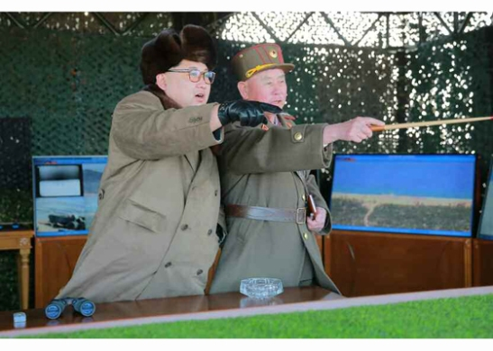 Kim Jong Un is briefed about a landing and anti-landing drill.  Also in attendance is Chief of the KPA General Staff General Ri Myong Su (Photo: Rodong Sinmun).