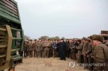 Kim Jong Un inspects a multiple-launch rocket system [MLRS] with senior munitions industry and Korean People's Army officials (Photo: KCNA-Yonhap).