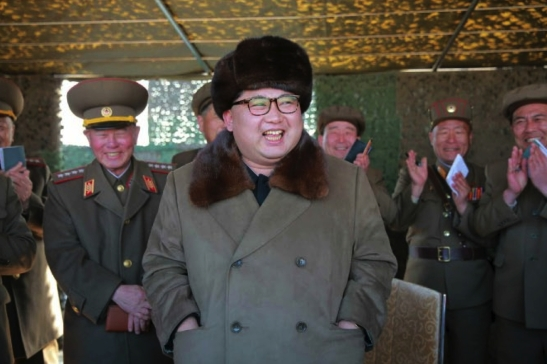 Kim Jong Un observs the test firing of a new 300 mm multiple launch rocket system (Photo: Rodong Sinmun).