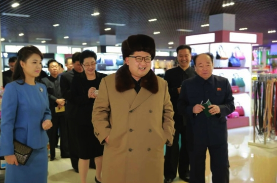 Kim Jong Un tours the Mirae Shop in Pyongyang.  Also in attendance are his wife Ri Sol Ju (left) and WPK Finance and Accounting Department deputy director Jon Il Chun (right) (Photo: Rodong Sinmun).
