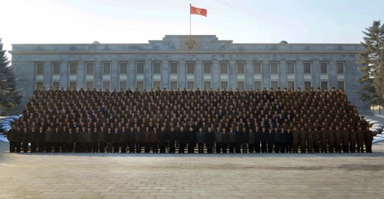 Kim Jong Un poses for a commemorative photo with personnel involved in the January 2016 nuclear test in front of the WPK Central Committee Office Building #1 (Photo: Rodong Sinmun).