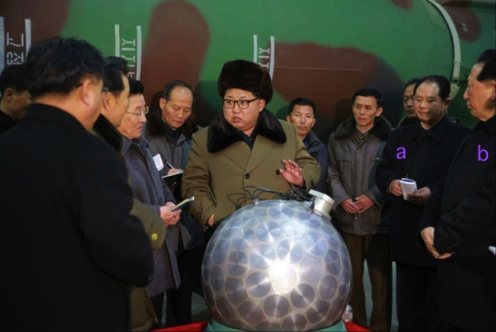 Kim Jong Un tours a facility near Pyongyang and meets with officials and personnel involved in the DPRK's nuclear weapons program.  Also seen in attendance are: Deputy Director of the WPK Machine-Building Industry (Military Industry) Department Hong Yong Chil (a) and head of the Nuclear Bureau (and former Yo'ngbyo'n manager) Hong Sung Mu (B) (Photo: Rodong Sinmun).