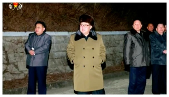 Kim Jong Un watches the conclusion of a mobile ballistic missile test (Photo: KCTV screen grab).