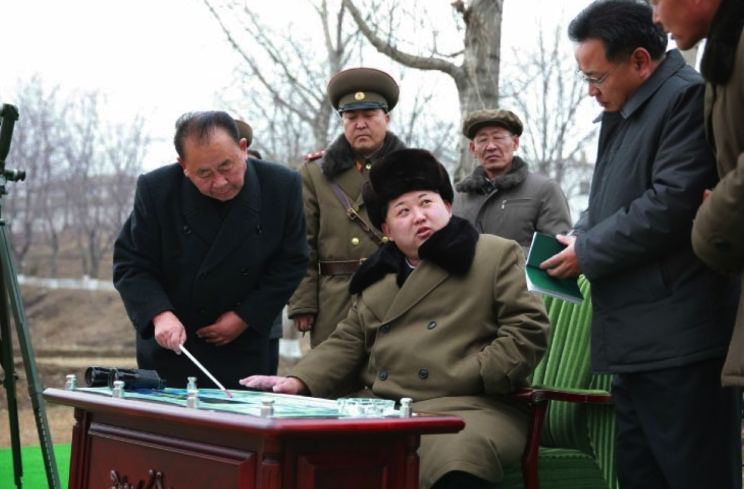 Ri Pyong Chol  (holding a pointer) with Kim Jong Un during a missile simulation in March 2016