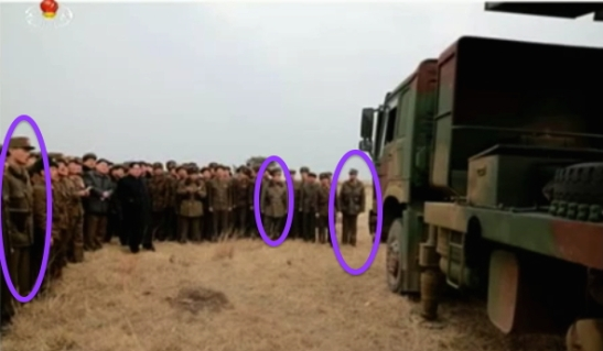 Kim Jong Un inspects a new model MLRS.  Noted in the photo are members of Jong Un's personal security escort (Photo: KCTV screen grab).