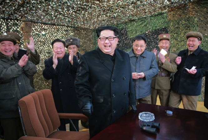 Kim Jong Un observes the test of multiple-launch rockets systems [MLRS] (Photo: Rodong Sinmun).