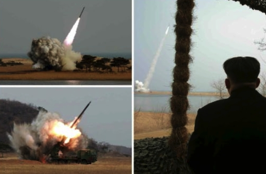 Tests of what appear to be a newer 300 mm MLRS.  According to DPRK state media, the MLRS will be deployed to the contry's reserve military training units (Photos: KCNA/Rodong Sinmun).