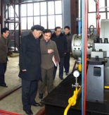 DPRK Premier Pak Pong Ju is briefed at the Ponghwa Chemical Factory in North P'yo'ngan Province (Photo: KCNA).