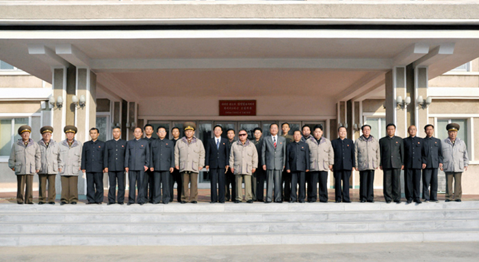 A commemorative photograph of late DPRK leader Kim Jong Il and Kim Jong Un at T'aeso'ng Machine Factory with factory managers, senior Korean People's Army [KPA] and WPK officials in November 2011 (Photo: NK Leadership Watch file photo/KCNA).