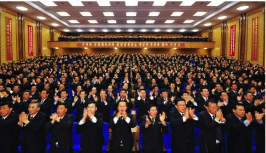 Party representatives at the DPRK Cabinet WPK Committee party conference applaud (Photo: Rodong Sinmun).