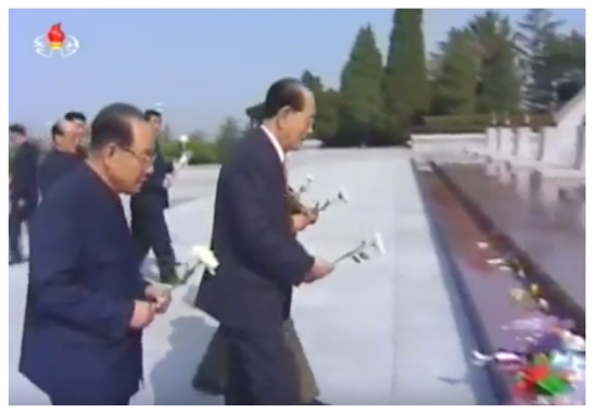 Senior Deputy Director of the WPK Organization Guidance Department Jo Yon Jun and SPA Presidium President Kim Yong Nam place flowers in front of the memorial bust of Kim Jong Suk, mother of late DPRK leader Kim Jong Il and Kim Kyong Hui and grandmother of Kim Jong Un, at the Revolutionary Martyrs' Cemetery in Pyongyang on April 25, 2016 (Photo: KCTV).