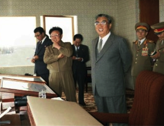 Late DPRK president and founder Kim Il Sung and late DPRK leader Kim Jong Il watch military exercises in 1989. Also in attendance were Yon Hyong Muk and O Jin U (Photo: Rodong Sinmun).