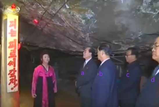 Senior DPRK officials tour Kunja-ri. In attendance are SPA Presidium President Kim Yong Nam [a], DPRK Premier Pak Pong Ju [b], WPK Machine-Building (Military) Industry Department Director Ri Man Gon [c] and Chief Secretary of the South P'yo'ngan WPK Committee Pak T'ae Song [d] (Photo: KCTV).
