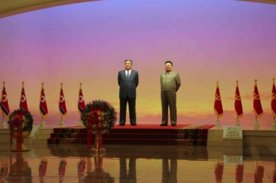 Floral baskets from Kim Jong Un and the Korean People's Army in front of the KIS and KJI statues at Ku'msusan to mark the 104th birth anniversary of late DPRK president and founder Kim Il-so'ng (Photo: Rodong Sinmun).