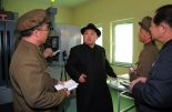 Kim Jong Un visits the machine plant managed by Ri Chol Ho (Photo: Rodong Sinmun).