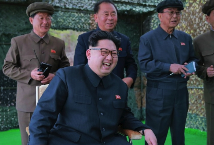 Kim Jong Un observes the test firing of a submarine-launched ballistic missile.  Also in attendance, behind him, are Ri Pyong Chol (center) and Ri Man Gon (right) (Photo: Rodong Sinmun).
