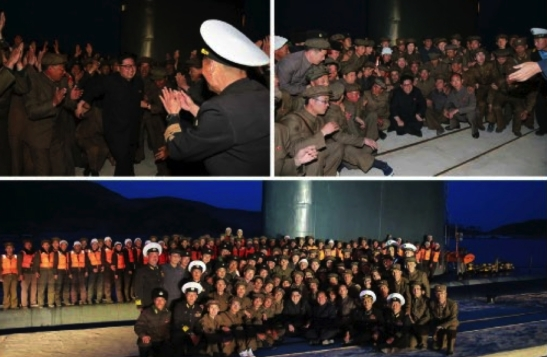 Kim Jong Un greets and poses for a commemorative photo with KPA Navy service members and DPRK defense industry personnel involved in the test firing (Photos: Rodong Sinmun/KCNA).