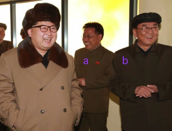 Kim Jong Un at the engine test, accompanied by WPK Military Industry Department deputy director Kim Jong Sik (a) and WPK Military Industry Department Director Ri Man Gon (b) (Photo: Rodong Sinmun).