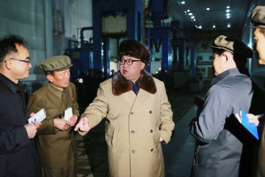 Kim Jong Un visits the Tonghu'ngsan Machine Plant in Hamhu'ng, South Hamgyo'ng Province. Also in attendance are WPK Organization Guidance Department deputy director Jo Yong Won (left) and WPK Military (machine-building) Industry Department deputy director Hong Yong Chil (2nd right) (Photo: Rodong Sinmun).