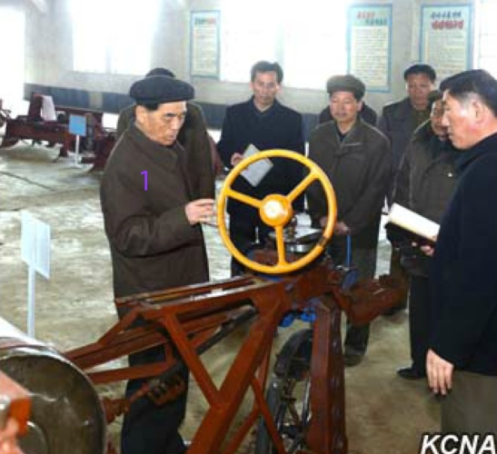 DPRK Premier Pak Pong Ju (1) inspects a product of the Haeju Tractor Factory (Photo: KCNA).