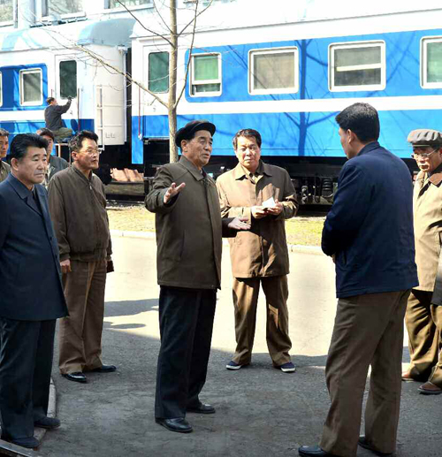 DPRK Premier Pak Pong Ju talks with a manager at Kim Jong T'ae Locomotive Factory in Pyongyang (Photo: Rodong Sinmun).