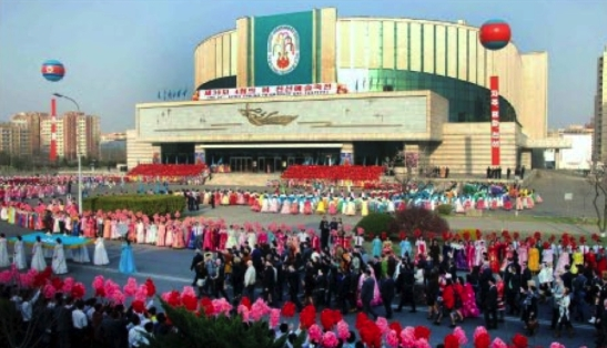 DPRK performing artists and participants at the 30th Spring Friendship Arts Festival, held in conjunction with celebrations for late DPRK President and founder Kim Il-so'ng, gather outside the East Pyongyang Grand Theater on March 11, 2016 (Photo: Rodong Sinmun).