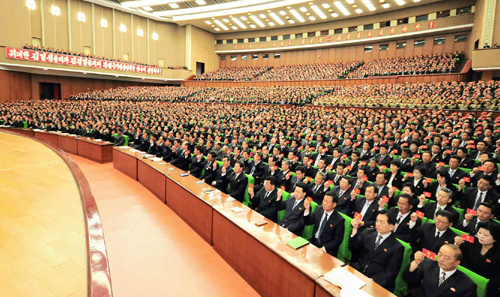Party conference participants hold up their membership credentials during the Pyongyang Party Conference (Photo: Rodong Sinmun).