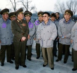 Ri Myong Su [a], Hyon Chol Hae [b] and Kim Yong Chun [c] with late DPRK leader Kim Jong Il on a field inspection in December 1996 (Photo: NK Leadership Watch file photo).
