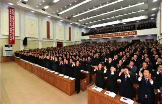 View of delegates (party representatives) drawn from basic party organizations, and city and county WPK committees applaud during South P'yo'ngan's provincial party conference held in P'yo'ngso'ng during April 17 and April 18 (Photo: Rodong Sinmun).