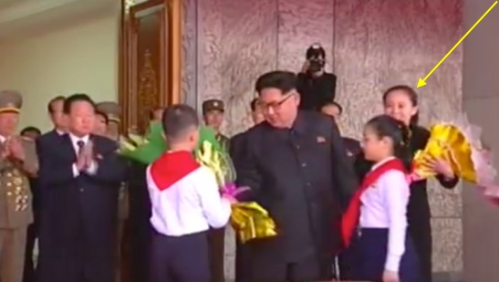 Kim Jong Un receives floral bouquets from members of the Korean Children's Union on May 10, 2016 prior to the start of a rally and parade celebrating the 7th Party Congress.  The floral bouquets are collected by his younger sister Kim Yo Jong, deputy director of the WPK Propaganda and Agitation Department (Photo: Korean Central TV).