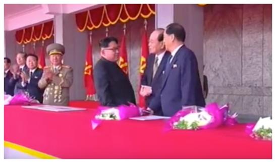 Kim Jong Un talks with WPK Political Bureau Presidium Members, SPA Presidium President Kim Yong Nam and DPRK Premier Pak Pong Ju during a May 10, 2016 parade celebrating the 7th Party Congress (Photo: Korean Central TV).