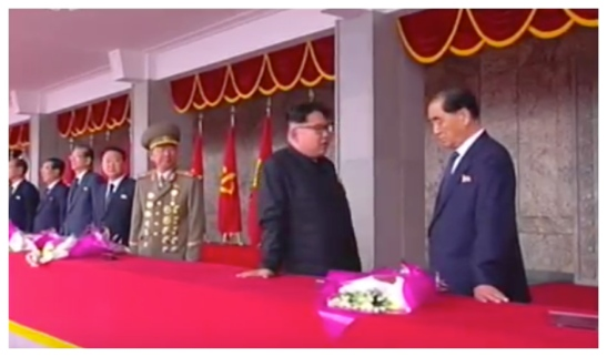 Kim Jong Un talks with WPK Political Bureau Presidium Member and DPRK Premier Pak Pong Ju during the speaking program at a May 10, 2016 rally and parade celebrating the 7th Party Congress (Photo: Korean Central TV).