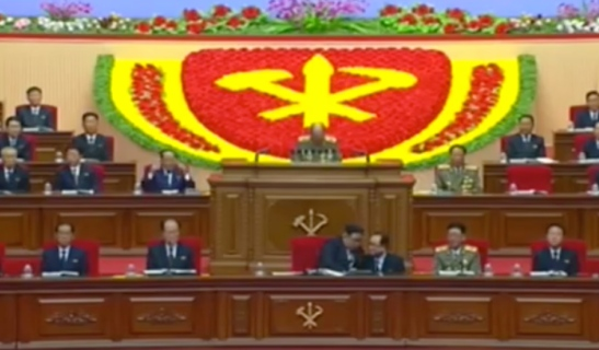 Kim Jong Un confers with WPK Organization Guidance Department Deputy Director Jo Yong Won during the second day of the 7th Party Congress as General Ri Myong Su delivers a speech (Photo: Korean Central TV).