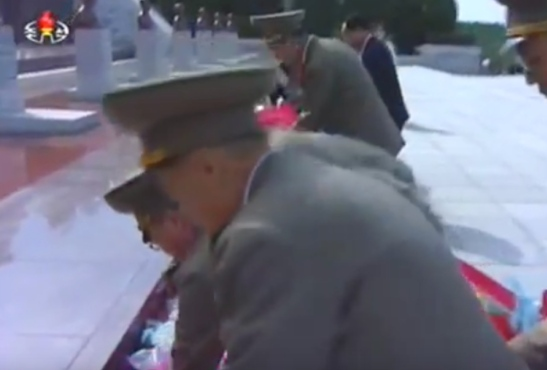 7th Party Congress participants place floral bouquets in front of the memorial bust of Kim Jong Suk at Revolutionary Martyrs' Cemetery on May 4, 2016 (Photo: Korean Central TV).