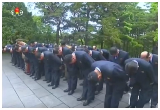 7th Party Congress participants bow in front of the graves of Kim Hyo'ng-chik and Kang Pak-sok in Mangyo'ngdae, Pyongyang on May 3, 2016 (Photo: Korean Central TV).