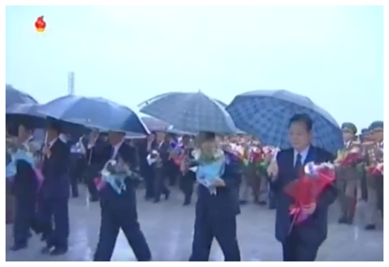 Senior Workers' Party of Korea officials bring floral bouquets to the KIS and KJI statues on Mansu Hill on May 3, 2016 (Photo: Korean Central TV).