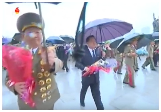 KPA General Political Department Director, WPK Political Bureau Presidium Member and National Defense Commission Vice Chairman Hwang Pyong So and WPK Secretary and WPK Political Bureau Member Choe Ryong Hae deliver floral bouquets to the foot of the Kim Il Sung and Kim Jong Il statues on Mansu Hill on May 3, 2016 (Photo: Korean Central TV).