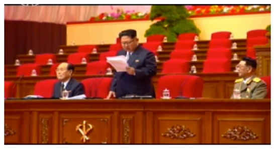 Kim Jong Un delivers the opening speech of the 7th Party Congress. With him are the two current members of the WPK Political Bureau Presidium (Standing Committee): Kim Yong Nam (left) and Vice Marshal Hwang Pyong So (right) (Photo: Korean Central TV).