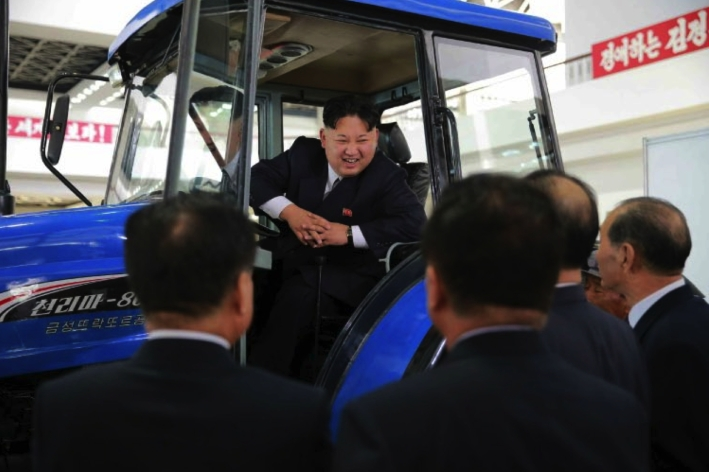 Kim Jong Un sits in a tractor manufactured by the Ku'mso'ng Tractor Plant in Chagang Province whilse touring an exhibition on machines and equipment (Photo: Rodong Sinmun).